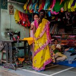 A woman is measured for a sari in a small town in India