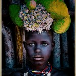 girl from Karo Tribe witih headdress and beads