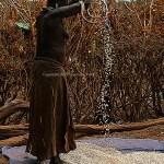 Dasennetch woman winnowing grain