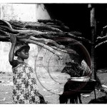 Ghana: girl carries headload of wood