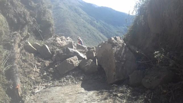 boulders block the road