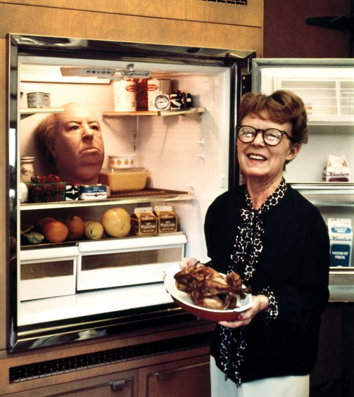 Alfred Hitchcock's wife Alma Reville with his head in the refrigerator (1974)