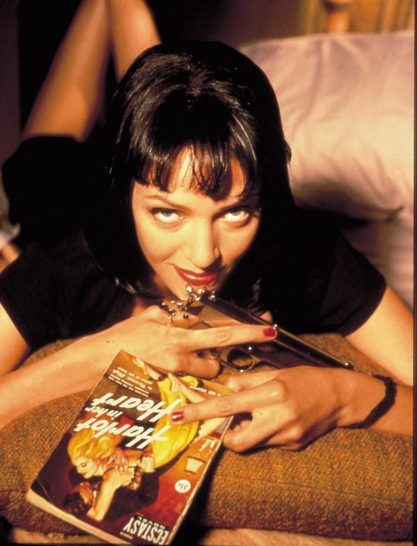 Uma Thurman as Mia Wallace with Pulp Magazines and Gun - Pulp Fiction Photoshoot - Quentin Tarantino