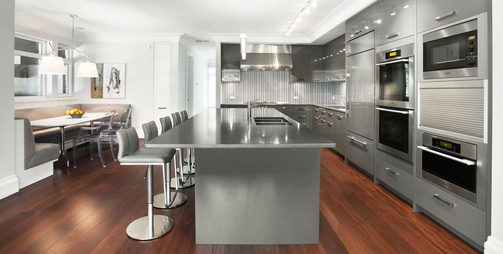 modern grey kitchen cabinets with hardwood flooring with light gray countertops