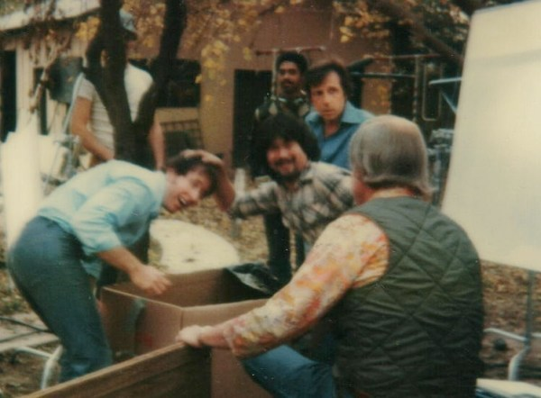 Cartel examines a set-up as Daryn Okada helps him with a better view of the coffin. Sound mixer Deverle Jones watches in the background with Al Valletta