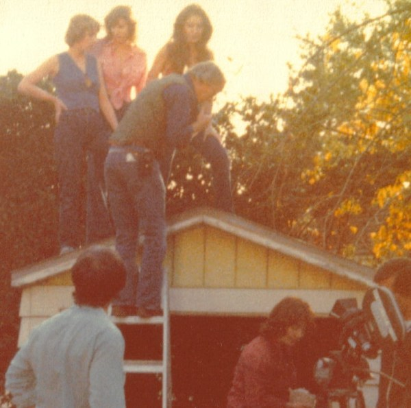 Dink Reed takes a meter reading as actresses stand on a roof for a low-angle shot to match the treeless desert sequence