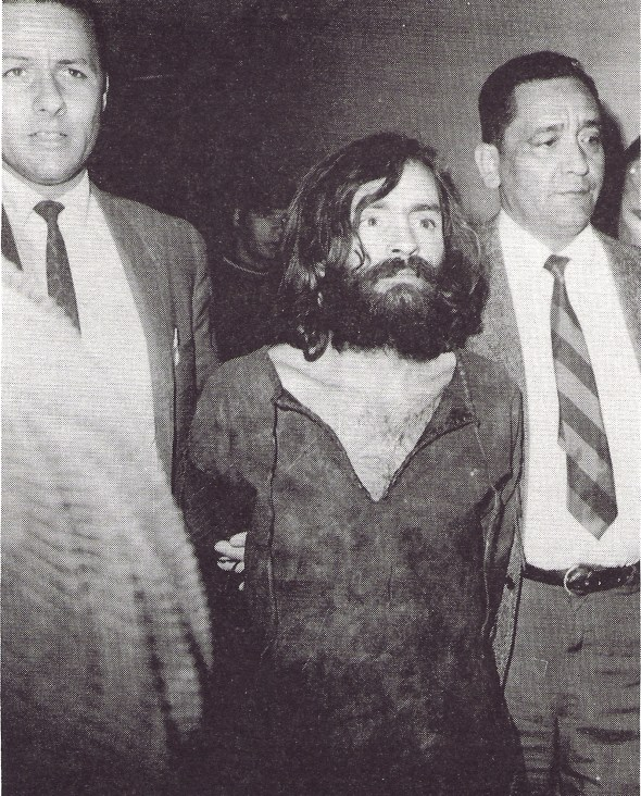 Manson escorted to court in Independence, California. He became a cult hero to many confused radicals during and after the murder trial but Manson was a PR disaster for the genuine goals of the counterculture. WIDE WORLD PHOTOS