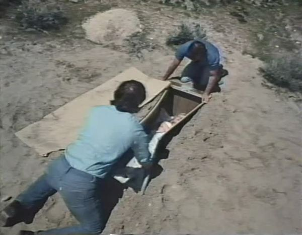 Rand and Jason dig up the crate after the men leave.