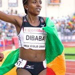 Tirunesh Dibaba celebrates her new world record in the 5,000 meters in 2008. Photo by Ragnar Singsaas.