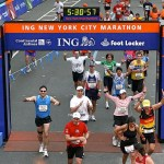 Runners cross the ING New York City Marathon finish line. Photo by Matthew Hutchinson.