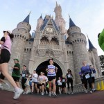 Racers run through Cinderella's Castle during the Walt Disney World Half Marathon. Photo courtesy of runDisney/Todd Anderson.