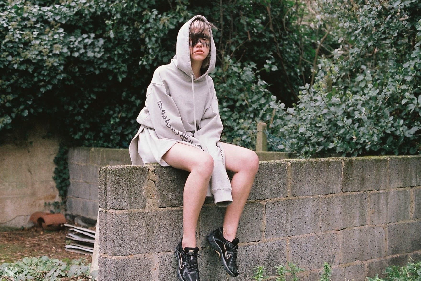 VETEMENTS jumper; model's own shoes.