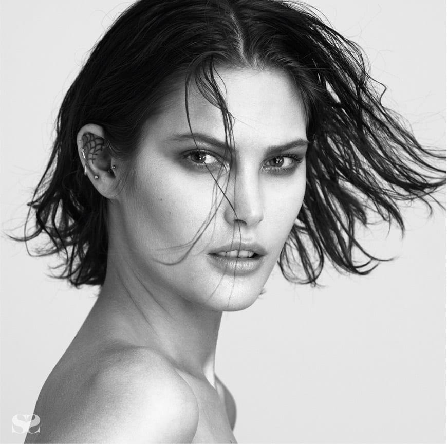 Model wears own earrings throughout.