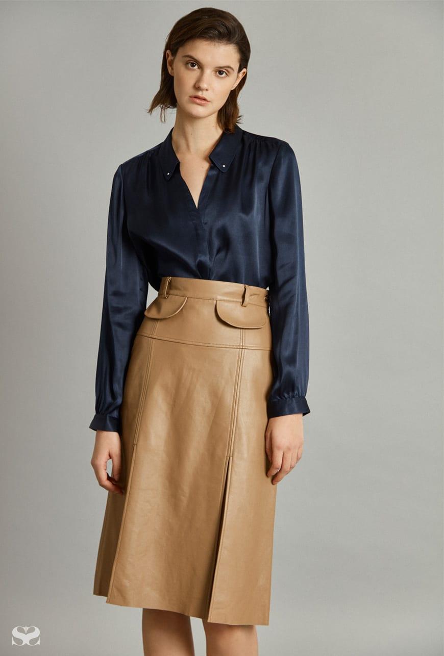 DAVID LAWRENCE shirt; KATE SYLVESTER skirt.