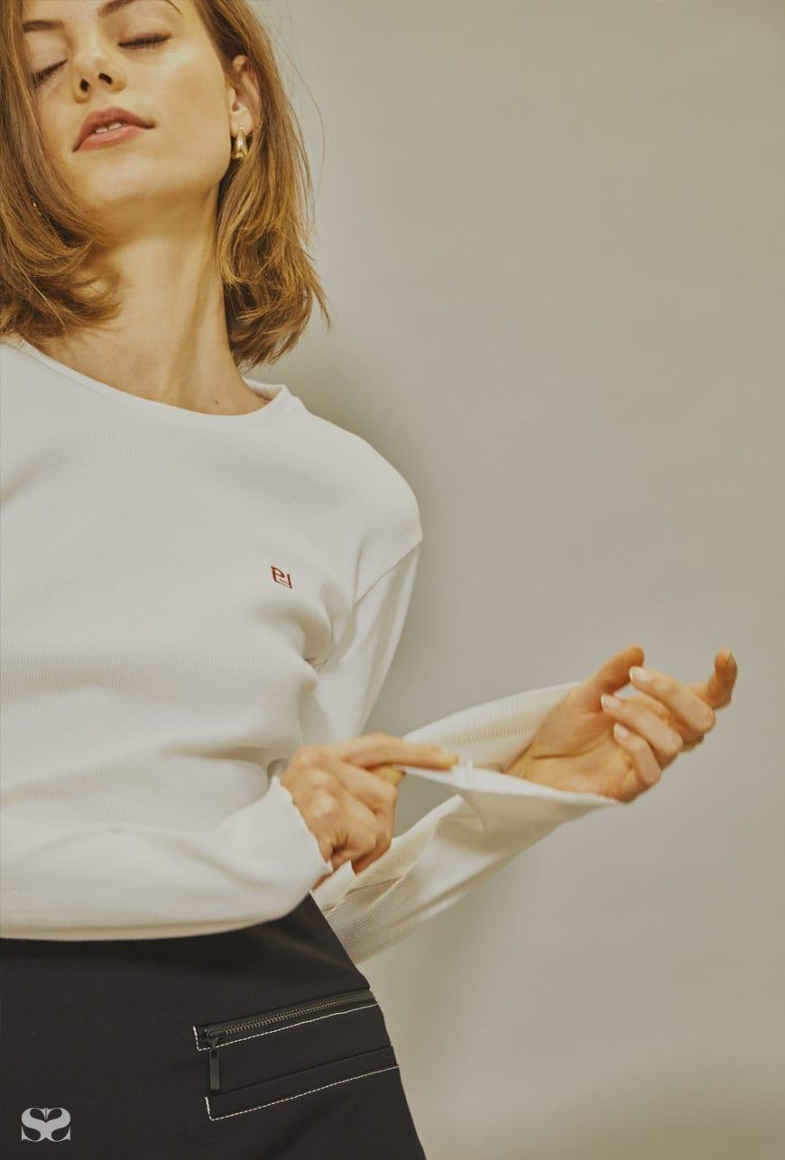 PAR FEMME top; CUE skirt.