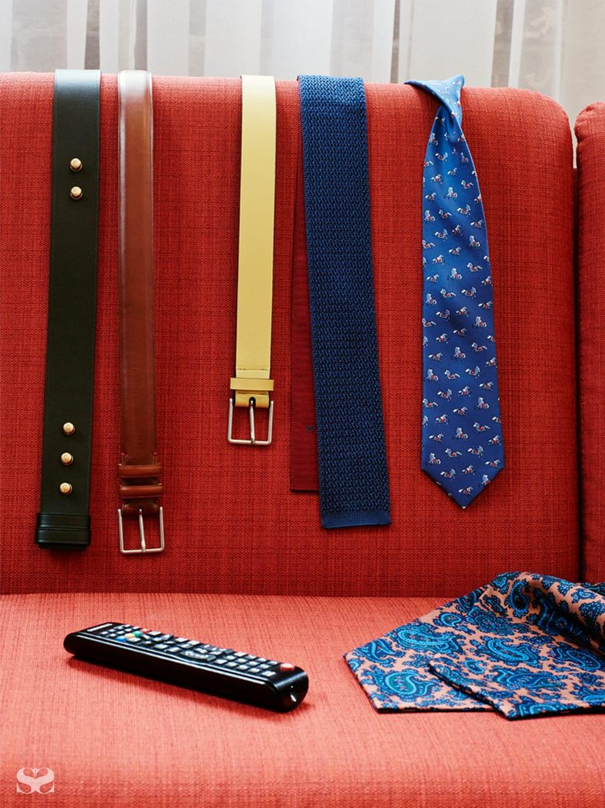 PRADA belt; PAUL SMITH belts; HERMÈS ties; cravat from Strand Hatters.