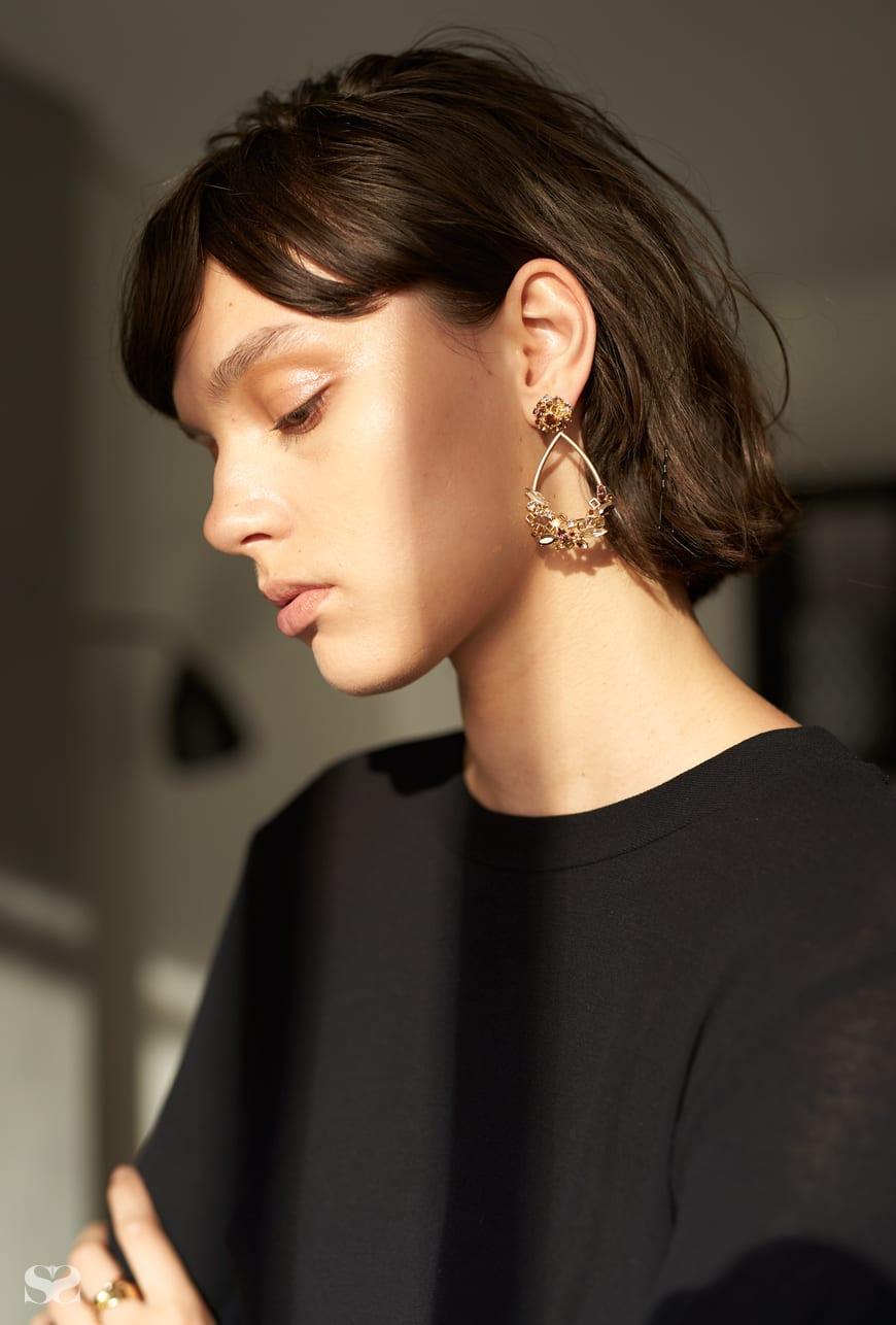 MARRIMEKKO top; MIMCO earrings and rings.