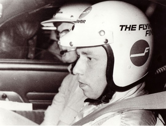 "Leo Kinnunen, an original ""Flying Finn"" behind AYA-10 steering wheel."