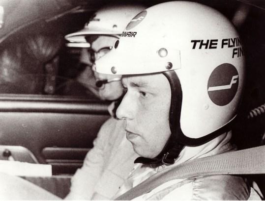 """Leo Kinnunen, an original """"Flying Finn"""" behind AYA-10 steering wheel."""