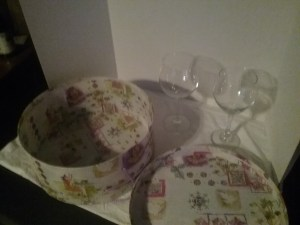 A hatbox and set of wine glasses