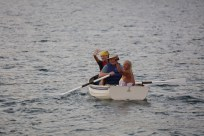 "Eliza, Ted, & ""C"" rowing back to their boat"
