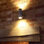 Fireplace lighting with wooden beams by Sam Coles Lighting 01