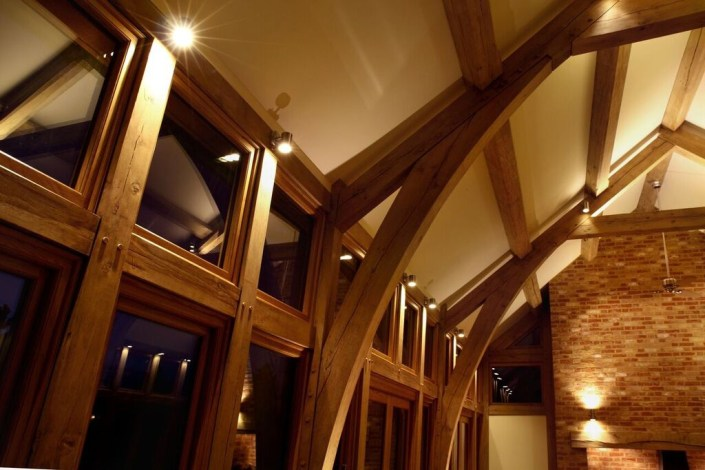 Lounge lighting with wooden beams by Sam Coles Lighting 02
