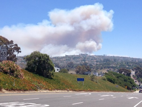 Plumes of smoke are seen from southbound Interstate 5 in San Clemente. It is the third fire on the base and has burned 25 acres. Photo by Andrea Swayne