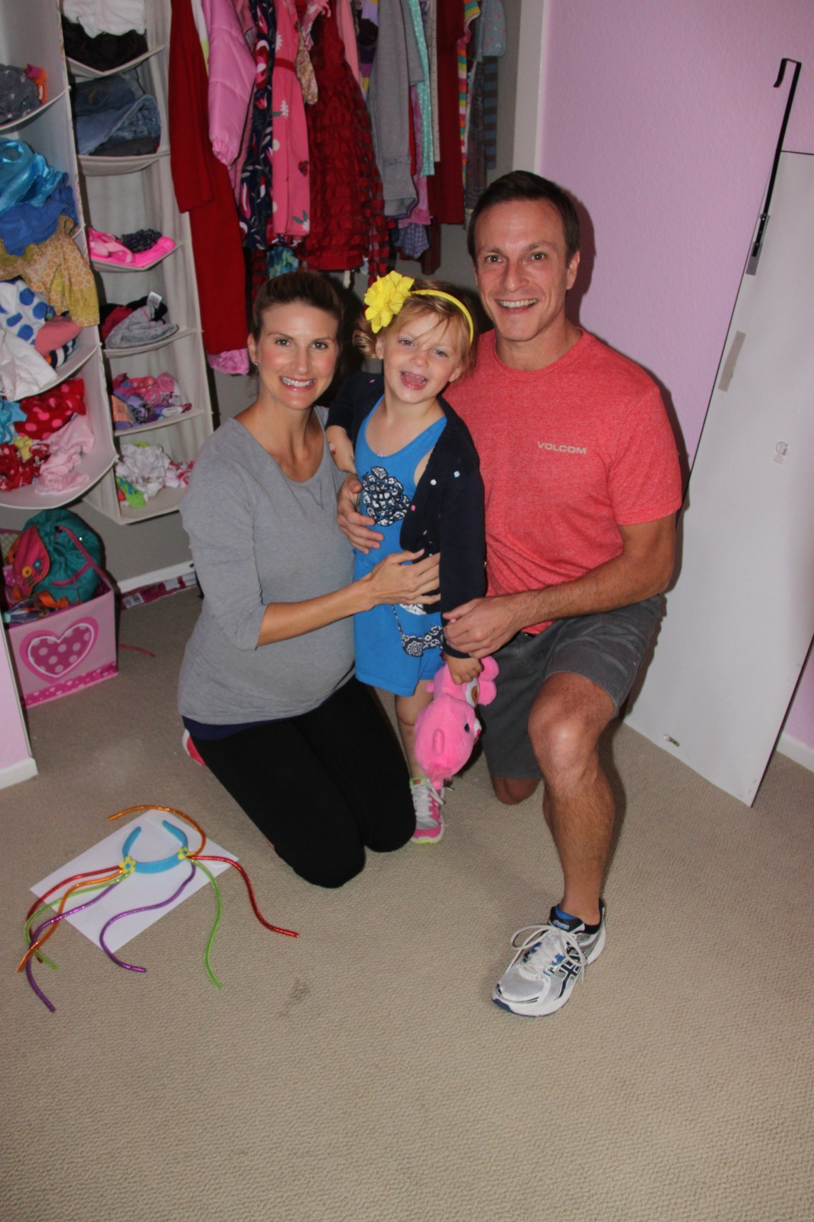 Before volunteers transfomed 5-year-old Raelyn Beckler's room into a haven fit for a princess, her family, including mom Rebecca and dad Greg, were sent on a Legoland Adventure. Here, the Becklers flash a smile before leaving. Photo: Shana Sutherland
