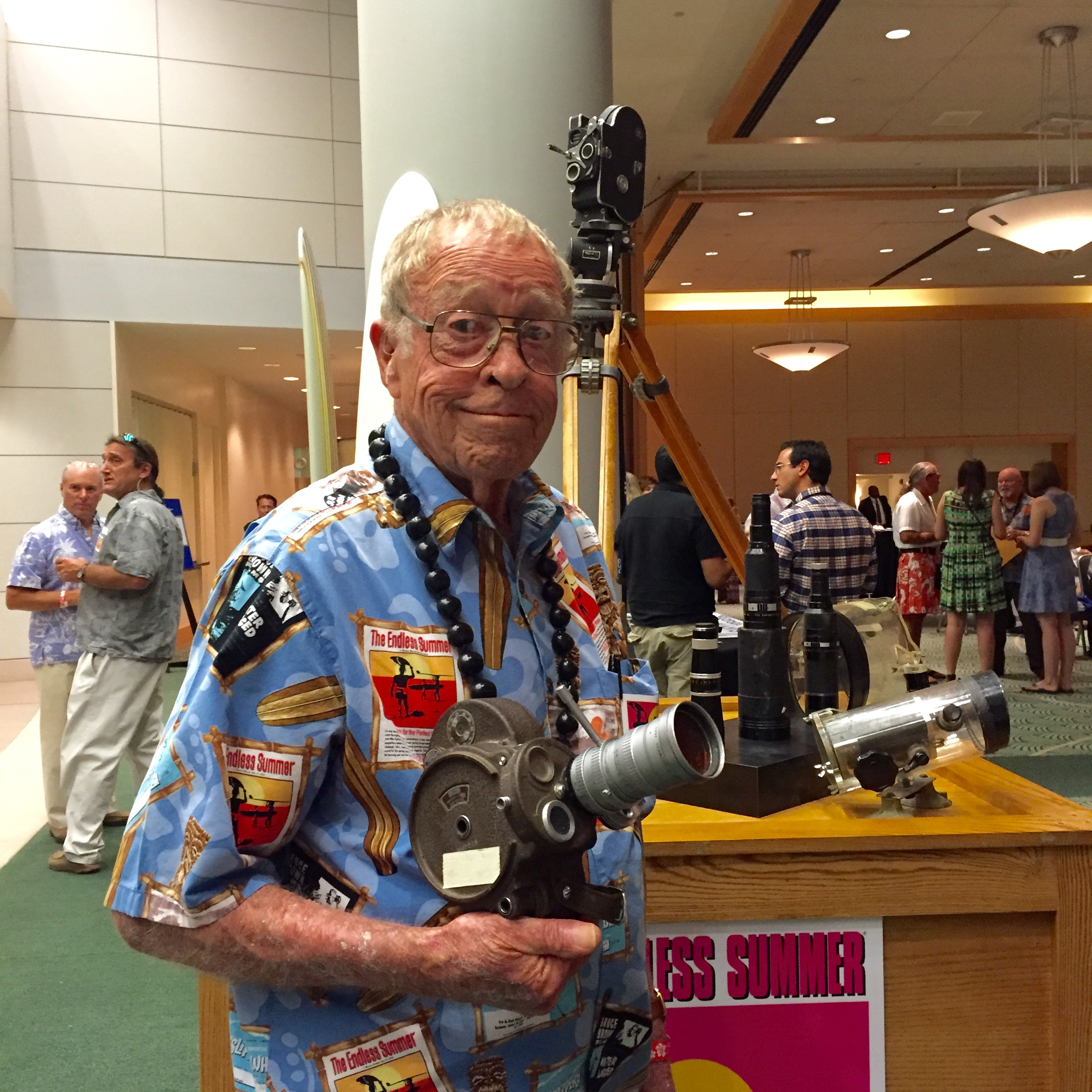 Bruce Brown Holds One Of The Cameras He Used A Half Century Ago In