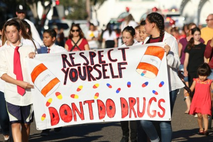 Children march for the Red Ribbon Week parade on Monday down Avenida Del Mar. Photo: Eric Heinz