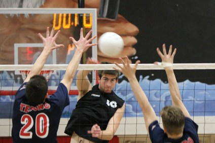 San Clemente's Kyler Presho hits against Tesoro during a boys volleyball match on April 12. Photo: Monica Merrill