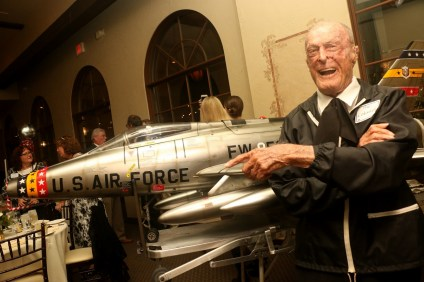 Col. Robert Thacker stands next to a model airplane of an F-100 bomber, a replica of the plane he flew during wartime. Thacker spent 31 years in the U.S. Air Force and commanded bomber planes in World War II. On Saturday, Feb. 18, he turned 99.  Photo: Eric Heinz