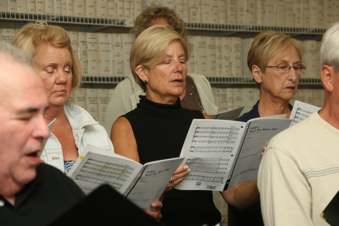 The San Clemente Choral Society practices prior to their May 6 concert, trying to emote in the middle of a piece they will perform during rehearsal on Tuesday, April 25.