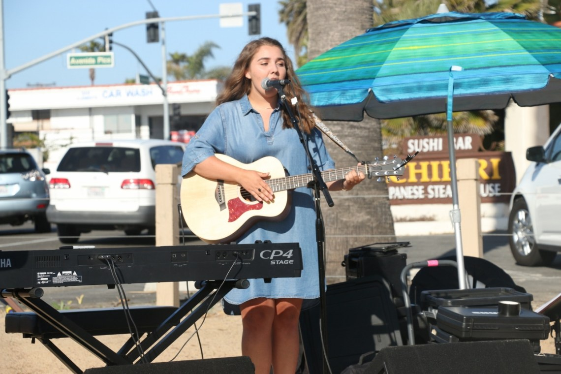 Maddy Vance performs during the North Beach farmer's market opening week on April 12.