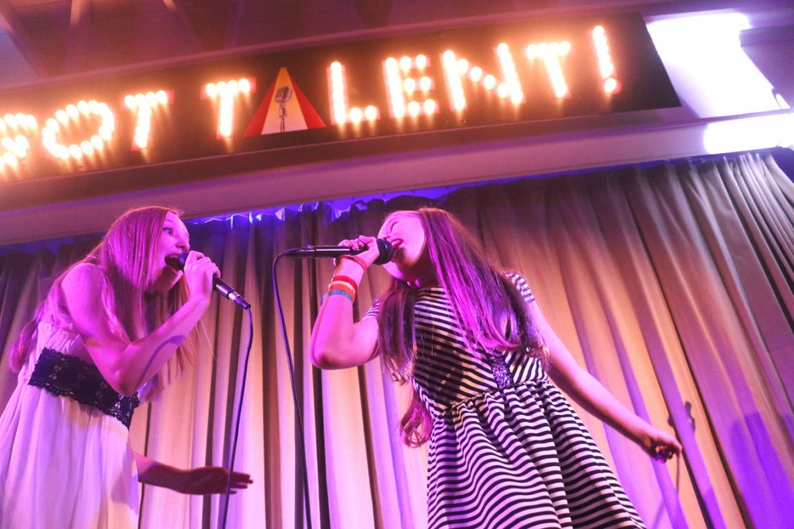 Avery and Alexa Roemer, sisters who have gained local fame for singing about dogs and raising money for animal shelters, perform during San Clemente's Got Talent competition on Friday, March 31.