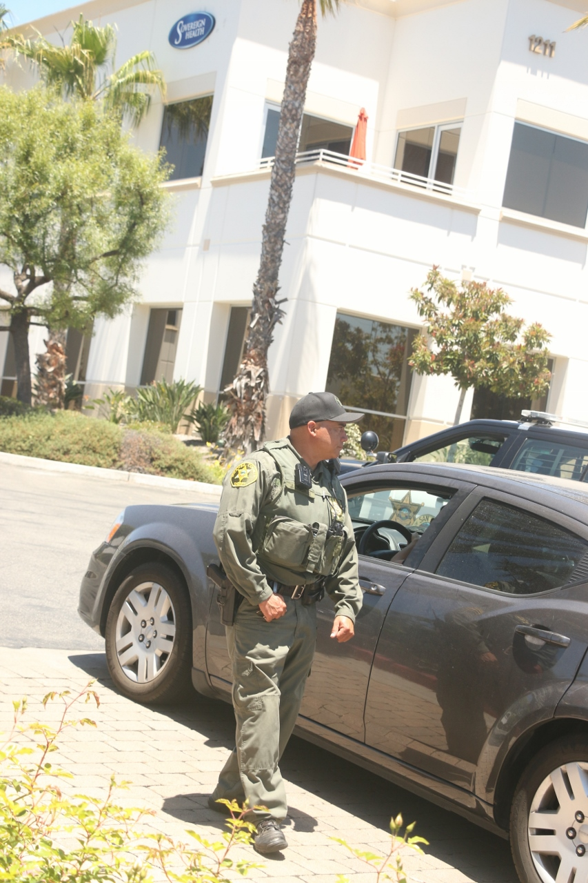 An Orange County Sheriff's Department deputy guards the entrance to the parking lot to Sovereign Health, where federal agents began an investigation on Tuesday, June 13. The investigation is ongoing. Photo: Eric Heinz