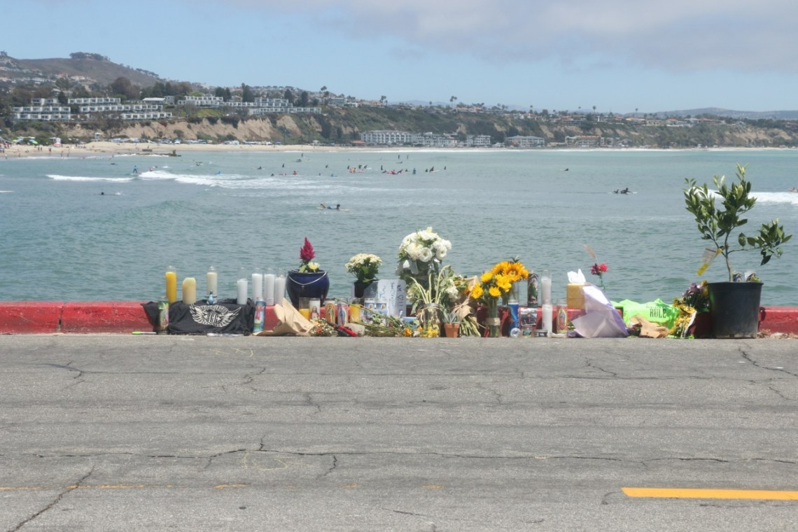 Flowers, pictures and farewell messages were laid along the side of the road on Wednesday, June 28, at the end of the jetty on Puerto Place in Dana Point. Nathan Smith, 9, of Dana Point sustained fatal injuries at the location in a skateboarding accident on Sunday, June 25. Smtih was a Las Palmas Elementary School student. Photo: Eric Heinz