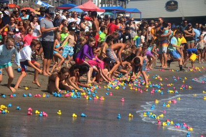 The Rubber Duck Race is possibly one of the most sought-after games of chance at the Ocean Festival, drawing hundreds of participants each year. Sometimes, grand prizes have been as lavish as weeklong vacations to Tahiti. Photo: Eric Heinz