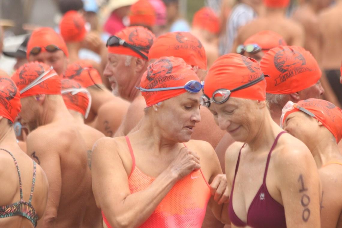 Swimmers prepare for the popular one-mile ocean swim at Ocean Fest. Photo: Eric Heinz