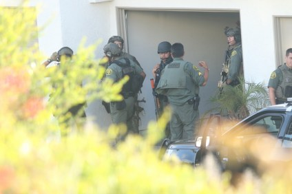 Orange County Sheriff's Department SWAT personnel surrounds a condominium unit in the Tennis Villas at Monarch Beach on Sunday, July 23. Photo: Eric Heinz