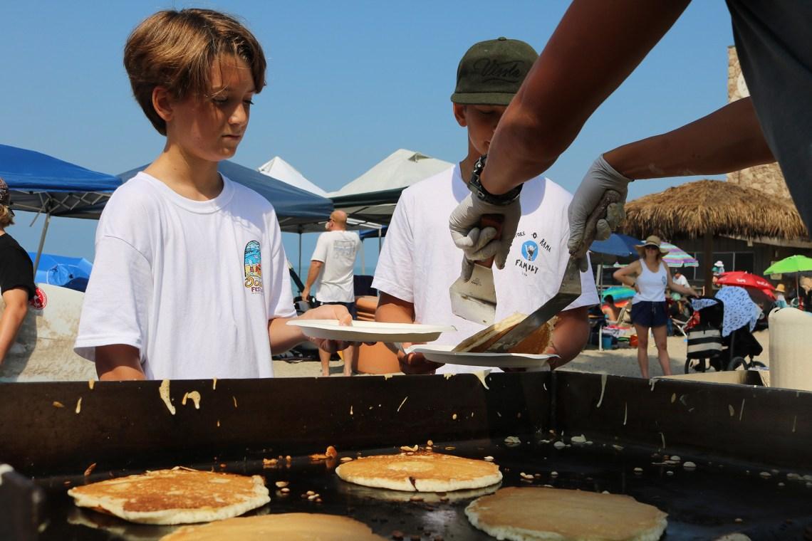 Kids enjoy a pancake breakfast during Ocean Fest. Photo: Eric Heinz