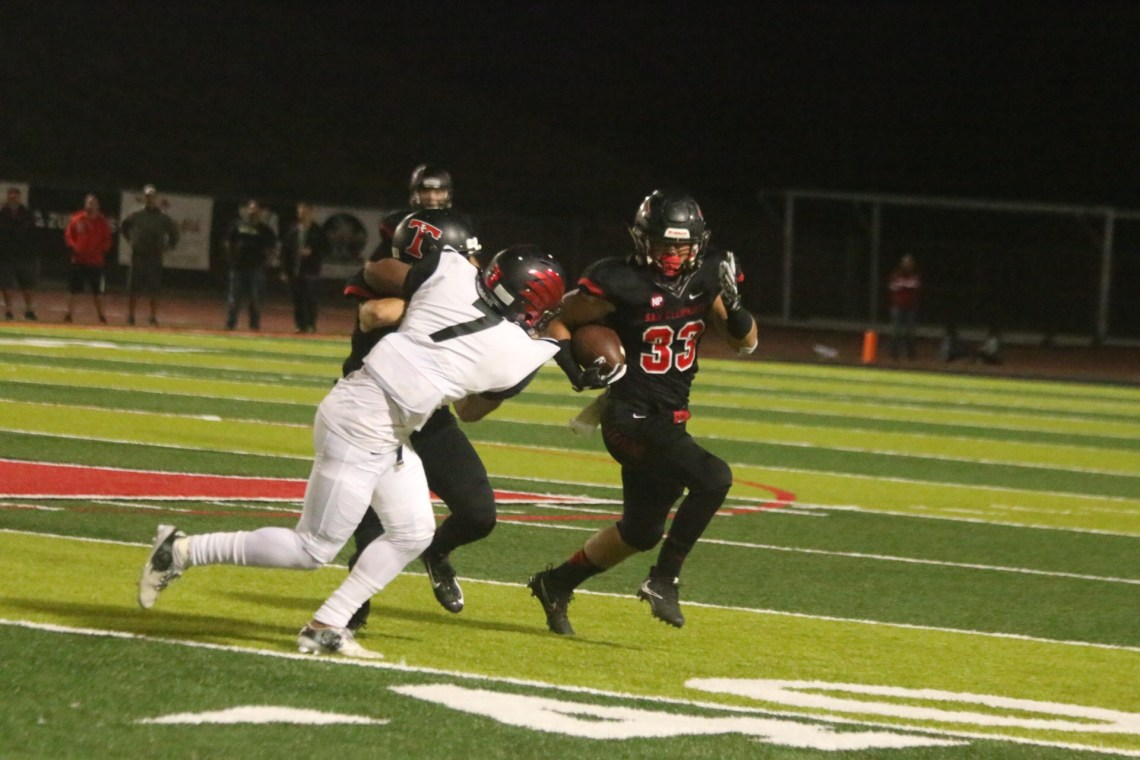 Austin Whitsett scored two rushing touchdowns against Murrieta Valley on Sept. 15. Photo: Eric Heinz