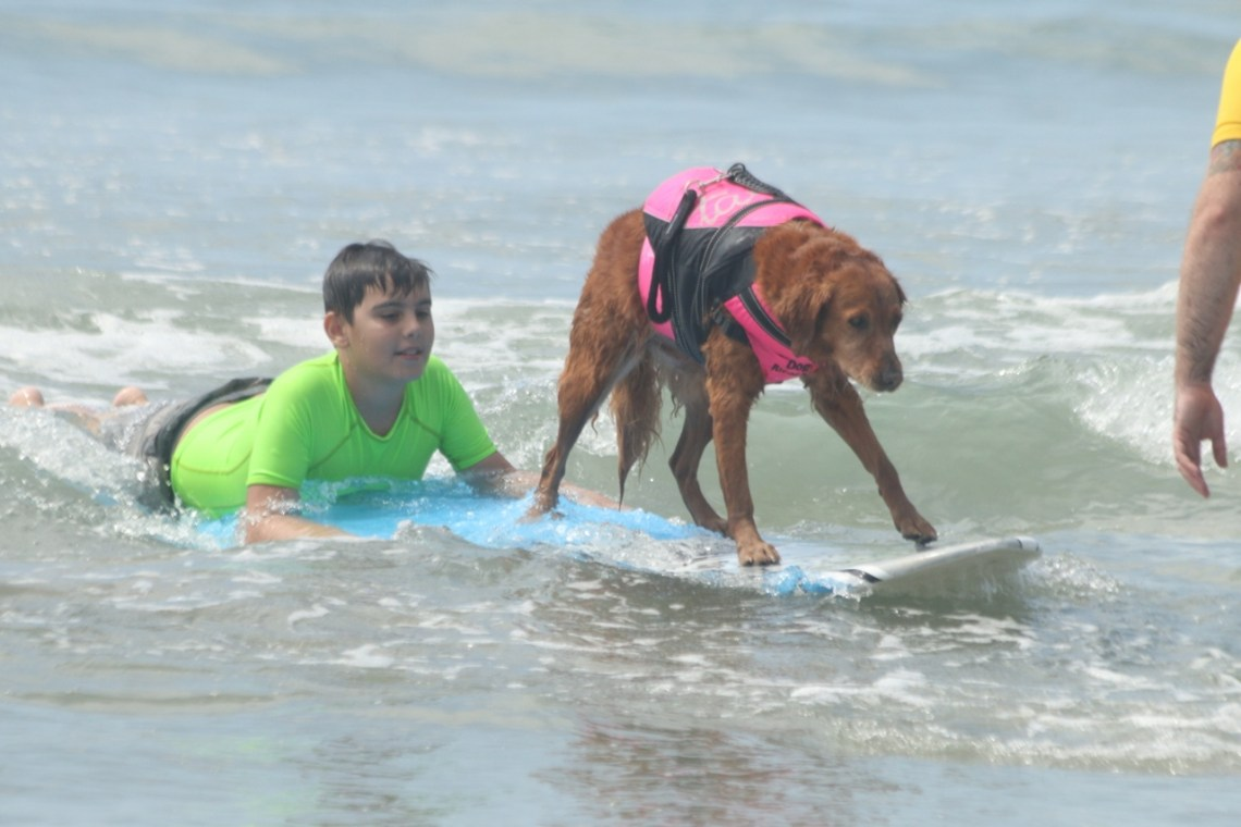 Children were able to surf the small waves of Linda Lane Beach on Sept. 16 with the Special Fishies program.