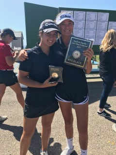 Golfers Olivia French, left, and Emi Brown celebrate the Triton golf team's second-place finish at the Rainbow Sandals-Lady Triton Invitational. Photo: Courtesy