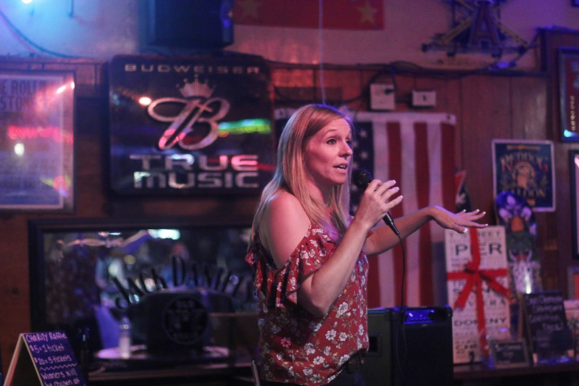 Tina Byrd, a manager at Goody's Tavern, emcees the start of the charity bingo night on Oct. 2. Photo: Eric Heinz