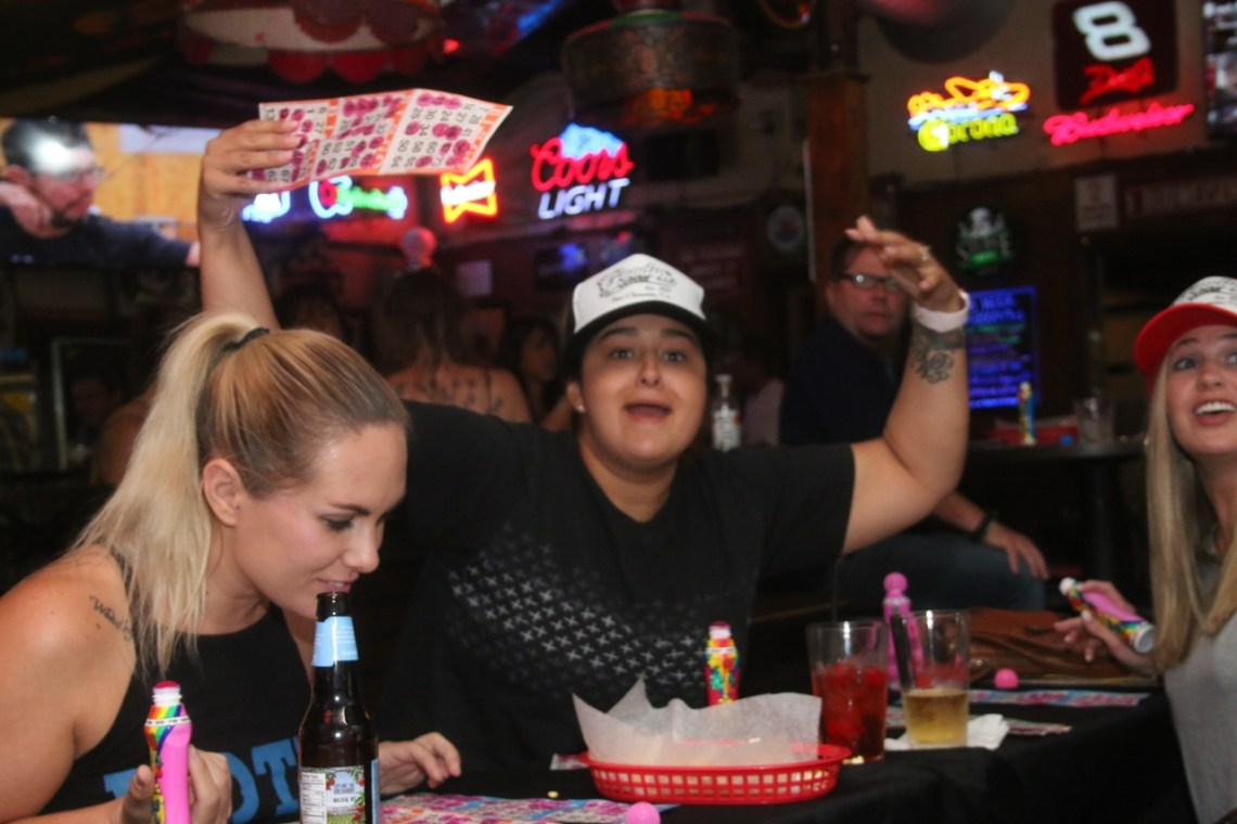 Lindsey Snegirev, left, examines her bingo card as Ashely Gibson reacts to just missing out on a chance to win on Oct. 2 at Goody's Tavern charity bingo night. Photo: Eric Heinz