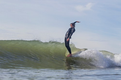 Caption: River Covey rides a longboard at Doheny State Beach. Photo: J.P. Van Swae