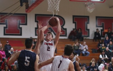 Jay Baggs goes up for a shot in San Clemente's win over Trabuco Hills, 55-42. Baggs had four points with 10 rebounds. Photo: Eric Heinz