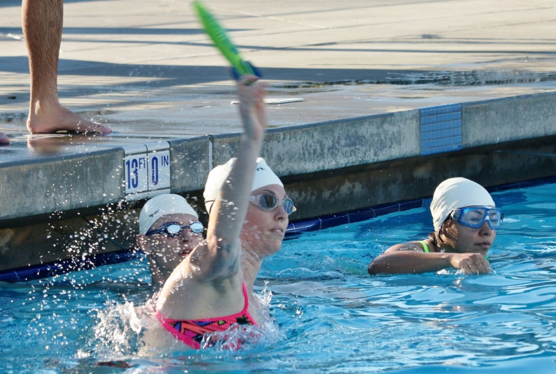 A player throws the torpedo to the opposing team during the first Aquabowl of the Underwater Torpedo League on Jan. 27 at the San Clemente Aquatics Center.